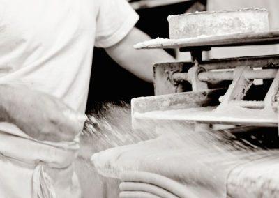 Adding flour to the dough